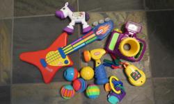 Teething keys, keychain and keys, play camera, zebra rattle with moveable legs, 5 different textured plastic balls, Little Tikes guitar, Little Tikes hammer that makes noise.