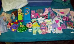 Comes with 1 Barbie Swan Lake, 2 barbie kids, 1 Just Girls doll and LOADS OF CLOTHES!!!! Clothes range from PJs to dresses to ponchos to shoes!!!! All in Very good quality!!!!