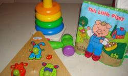 Assorted kids toys.  Fisher Price barn with animals, Fisher Price Stackables, 3-piece wooden puzzle, cloth book, toys hammer rattle, Lego Duplo blocks.  All are sold together and come from a smoke free home.