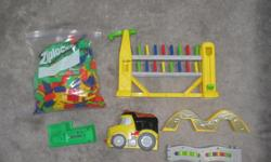$10 The Auto Domino Building Truck is a toy truck which drops dominos out the back end, lining them up in neat rows, ready to tumble. works great