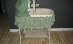 Baby bassinet, excellent condition like new, only used 4 months, has working mobile, 8 clasic songs, 5 soothing sounds, night light, vibrations, mobile arm swings away, mattress and 2 sheets, bassinet has wheels for easy moving, wheels lock, has lots of