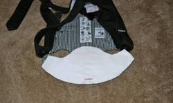 Baby Bjorn and Set of Two Bjorn Bibs Great condition. Bibs are removable and washable. Saves washing the Bjorn with every spit up! Bibs alone retailed for $25.00!! Non-smoking, no pet household.