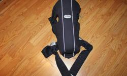 This is a navy colored Baby Bjorn Carrier.  In excellent condition.