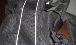 Black with silver trim - Baby Bjorn carrier. Good for infant 8 to 26 lbs. Gently used in excellent condition. I went through many types of carriers before I found this one. It is really a great one; easy on your back and completely adjustable.