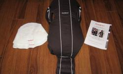Baby Bjorn carrier with two Baby Bjorn drool cloths.  Excellent condition. Contact trevorseanbarker@hotmail.com
