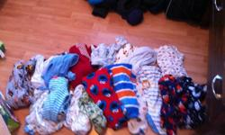 I have four diaper boxes filled with baby boy clothing ranging in size from 6-12 months.  There are outfits, sleepers, shirts, pants, and a few pairs of shoes.There is a 6-12 month Joe Brand Snowsuit.  A 12 month George Spring/Fall Jacket and a 3-6 month