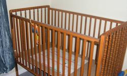 This is a Stork Craft baby crib.  In great shape.  The bottom can be raised for newborns.  The side rail can lower a bit as you can see in the picture.  We also have a mattress that you can have with it.  Both were used in a pet free and smoke free home.