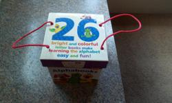 This set is like new! Learning the alphabet has never been more fun than with this Alphabooks Board Book Set from Baby Einstein. These 26 mini board books feature real-life photos and illustrations of everyday objects that help teach Baby about each