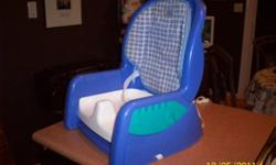 The First Years Baby Booster Seat with Straps to keep baby safe. Sorry no tray but very safe. Excellent Condition