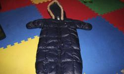 New, never used, blue baby gap warmest snowsuit. Size 3-6 months. Is downfilled. Has soft and cozy fleece inside. Has flip over mitts and zip out legs. Hoody can be zipped off. Is very warm and cosy. Can be used in a car seat. From pet and smoke free