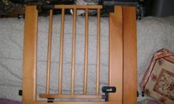 I HAVE TO BABY GATES   UP TO STANDARD CODES VERY SOILD   ONE IS MADE FROM EVENFLO AND IS STEAL THE OTHER IS MADE FROM SUMMER AND IS WOOD STYLE..AND VERY CONVENIENED...HAS A ONE TOUCH SWINGING DOOR STEP THREW
