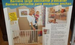 """Brand new still in the box Wide stairway wooden swing gate - 30"""" high - extend 46"""" - 63"""" wide - $35.00 and Plastic adjustable baby gate lightly used - $25.00 Pick up only."""