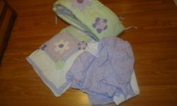 Purple,white and light green quilt,crib skirt and bumper pads.
