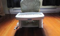 Sits on dining chair Secured by straps (very safe) Educational cards fit on table Excellent condition