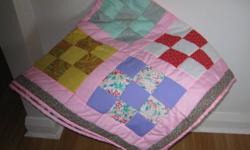 New hand made baby quilt.  Reversible.  Size 46.5 x 46.5.   Ad will be deleted  when  sold.   Thank  you.  WILL  SHIP.  519- 631- 2594.