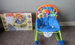 Excellend condition. Only used once. Baby rocking chair. $40.