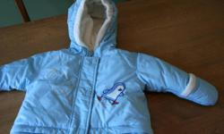 Light Blue with fleece lined hood Embroidered Penguin skating detail Zip off bunting bag bottom - turns into a winter jacket as baby grows fold over mitts used only once In immaculate condition