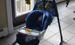Swing has fish mobile, plays soft music with changing light colours to sooth baby. Multiple swinging positions with speed adjustment and removable tray. Excellent condition, paid $160 plus tax on sale.
