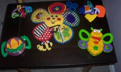 Assortment of Baby Toys - $2.00 EACH or $10.00 for EACH SET. Each photo is one set. Excellent Condition   Rolling mirror - SOLD