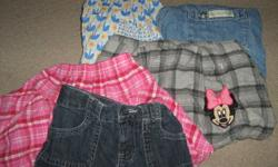 5 SKIRTS 2 LONG SLEEVES 1 SWEATER/ 1 DEMIN SHIRT 2 BATHING SUITS 7 PAIRS OF PANTS