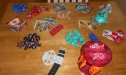 Large lot of Bakugan Over 50 plus cards, launcher, power ups and holder Well over $300 value