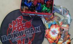 30+ Bakugans, portable mat and playing cards.