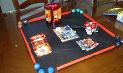 Bakugan pieces, game board, wrist holder, rotating Bakugan holder and cards. hardly played with.