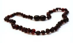 Baby J Kids Klothes just received new Baltic Amber teething Necklaces. Is your baby cranky and miserable because of teething? We have a natural way to help your baby. Baltic Sea Amber is a natural analgesic, anti-inflammatory and anti-anxiety. How does