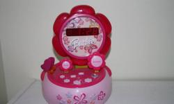 Works great.  Wake up to Barbie.  Easy to set and use.   Clean and from a smoke free home