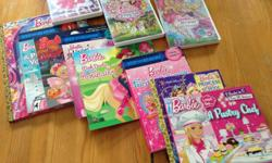 Various Barbie videos and soft/hardcover; Videos: Barbie - Mariposa and the Fairy Princess Barbie - A Fashion Fairytale Barbie and her sisters in a Pony Tale Soft cover books: Barbie - A Pet Vet (Step 1) Barbie - A Boo-tiful Halloween Barbie - A Fashion