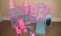 Barbie castle with furniture and other accessories. Some discolouration on the top, otherwise in great condition.