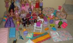Approximately 20 Barbie Dolls & accessories. Clothing, shoes, hats, purses etc. All for $30.00. Great Condition