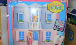 Barbie Fashion Home with furniture, pre-assembled and folds up for storage. For use with 11 1/2 inch fashion dolls. In excellent condition.