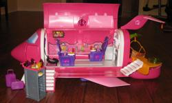 Barbie jet with accessories; in excellent condition.