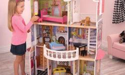Barbie 3 storey townhouse.House in great condition, including 2 barbies, furniture.