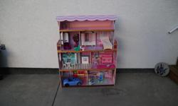 4 levels, 7 rooms of fun! We can include Barbie furniture (pictured) if you want. Selling because our girls have out-grown it.