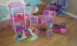Selling as a lot, 2 Barbie houses, 14 barbies (2 ken included in that lot) , jeep and convertible and carrying case. Random accessories and dresses and clothes.