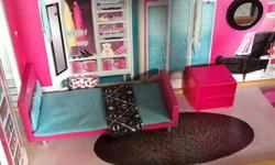 Three storey Barbie Play House, comes with movable furniture, and elevator. Bought three years ago for $179, still in great shape, almost like new.