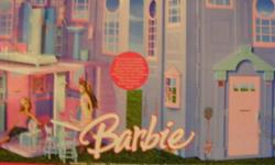 Barbie house, box unopened. Comes with two dolls. Would make great gift.