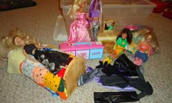 wooden handmade bed, dresser, and nightstand for barbies.Four barbie dolls,many cloths,shoes and items for them to wear.Blowup pink barbie chair.All for $60.00.phone  7647403 or 9611678.