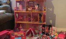 Everything in the pictures! The house, three levels with an elevator, Camper van, moped, jeep, camp tent, lots of Barbies and tons of clothing and accessories! Items can be sold separately as well :)