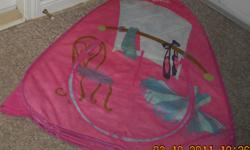 Pink Barbie tent with front and back door openings. Front door can be tied open. Made with soft thin fabric. Measures 32 inches at the widest and 36 inches tall. Folds to collapse into a thin tent for easy storage. Does have a small tear in the fabric