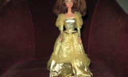 This Little Barbie is in a class by herself!.....Her hair beautifies the gorgeous  sheen of her dress...Dressed to kill...she'll be the Belle of the Ball!....Like-new condition...and comes from a smoke free home!,,,Asking $15.00