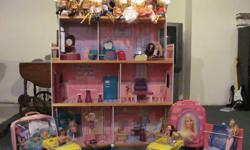 Barbie townhouse with 7 rooms, furniture, food, dishes, clothes, purses, luggage, 1 Demi Lavato doll, 1 Hannah Montanna doll, 1 Max Steele doll, 10 Barbies, 1 knock off barbie, 2 Kelly dolls & 1 of her friends, 8 Bratz dolls - 1 with child microphone, 3