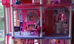 Barbie townhouse - in great used condition. Includes many accessories, food and dishes, working elevator, two barbies, baby, and pets. Plenty of sounds including doorbell, kitchen timer, and running water sound for the shower. Fireplace lights up and the