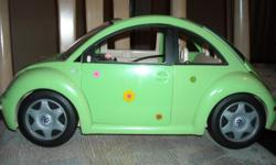 Barbie Volkswagon bug toy car, green, with flower decals. Made by Mattel in 2000. Doors and back trunk opens, has seat belts. Good condition, as shown in photos.