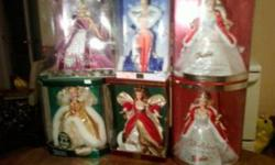 Barbies for Sale ,All mint in box ,Great for gifts or collectors   There the following that are mint in box NR   2005 Macklie Holiday Doll ( Fushia Dress) MINT NR                       $ 40.00 2003 Happy Holiday ( Bad Box) Mint NR