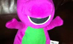 A toy Barney soft also a girls tummy mat with toys and water can go in it This ad was posted with the Kijiji Classifieds app.