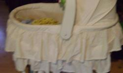 Bassinet for sale ..The basket part comes off and there is a changing table on the stand part ..The basket part fold up for easy traveling..