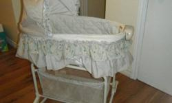 Bily Bassinet. Great condition, barely used. Virates, plays music, and has a light. Top part detaches and can be used anywhere as a rocker. Wheels retract so the whole thing can rock too.